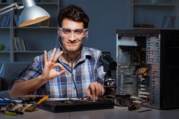 smiling computer repair service provider